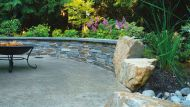 Stamped Concrete Patio With Ledgestone Wall