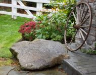 Stamped Concrete Meets Granite Boulder