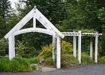 white backyard arbor